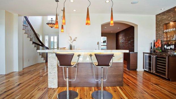 contemporary bar made of horizontal bamboo and a slab of vanilla onyx