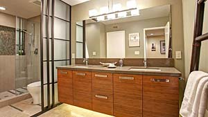 remodeled bathroom has bamboo cabinetry