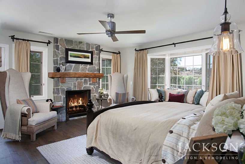 This Master Bedroom In A Modern Farmhouse Features A Fireplace In Arbutus  Stone With A Reclaimed Wood Mantle And A Cozy Window Seat With A View.