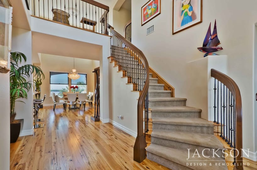A Sweeping Staircase Greets Visitors In The Elegant Entryway Of This Home  Remodeled For A Couple Who Love To Entertain. The Graceful Railing Is  Composed Of ...