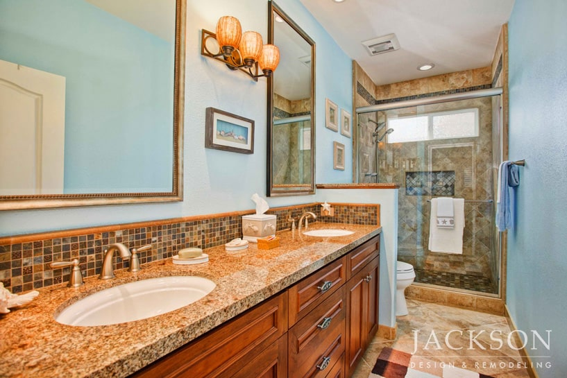 Designed for a teen daughter with a love of the ocean, this bathroom  soothes with calming shades of blue and sand. Intersecting planes of  marble, ...